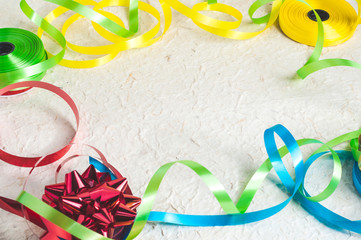 Colorful background with yellow, blue, green and red ribbon stripes on texture surface