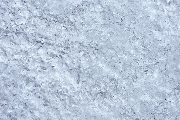 Abstract frozen ice background. The texture of the snow ice