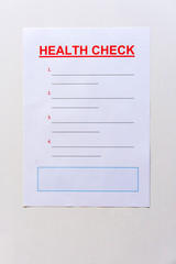 A blank health check form with text and lined copy space.