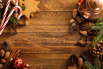 Christmas background with nuts, decorations and candy cane
