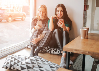 Young caucasian women using phone and saying no to life. Smartphone addiction concept