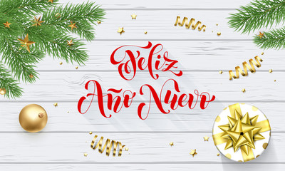 Feliz Ano Nuevo Spanish Happy New Year golden decoration and calligraphy font on white wooden background for greeting card. Vector Christmas gold shiny star on Xmas tree for winter holiday