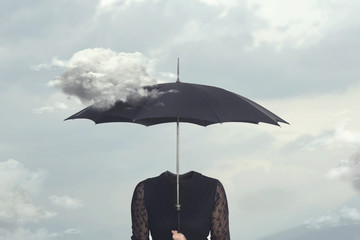 surreal moment of a cloud caressing the umbrella of a headless woman