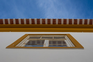 Window, roof and a blue sky