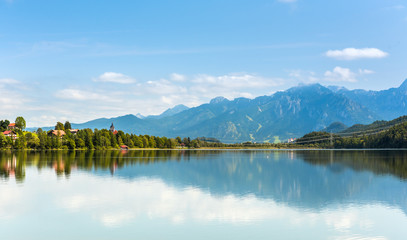 Green water Weissensee lake in Alps Mountains