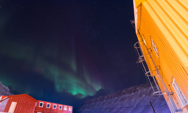 The polar arctic Northern lights aurora borealis sky star in Norway Svalbard in Longyearbyen city the moon mountains