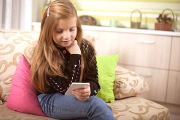 Little Caucasian girl  text her friends on social network