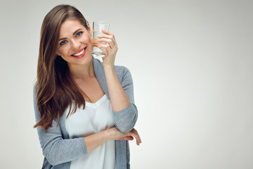Young smiling woman holding water glass. Isolated studio portrait