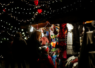 A woman with the girl look on displayed items at the Christmas market in Tallinn