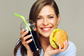 Happy woman holding American classic fast food set,