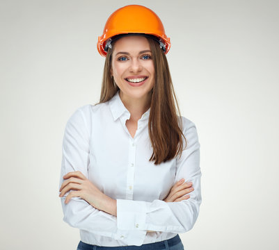 Smiling confident woman builder architect standing with crossed arms.