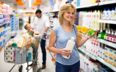Woman customer choosing shampoo