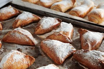 Fresh tasty bakery products on tray