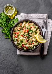 Traditional peruvian quinoa quinua salad in clay bowl, slate gray background