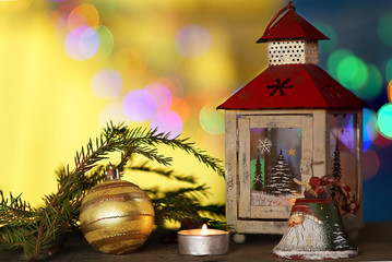 christmas decorations with candles under; colored blurred background.