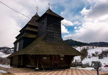 Uzhok, Ukraine - February, 25: Church of the Archangel Michael - UNESCO World Heritage. old wooden building in Carpathian mountains in winter