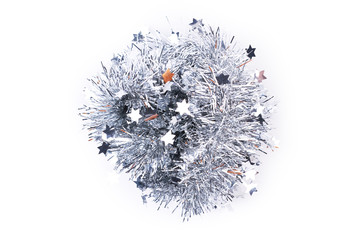 Silver tinsel pile on white background. Silver sparkle garland isolated on white background. New Year decorative element.