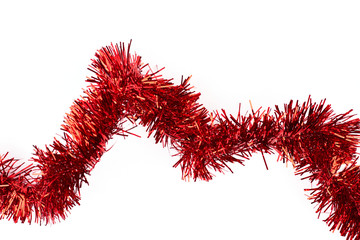 Red tinsel on white background. Line of bright glitter tinsel garland isolated on white background, horizontal image. New Year decorative element.