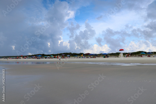 Vacation And Travel Background Seascape With Cloudy Sky Over Colorful Umbrellas Liuard Tower At