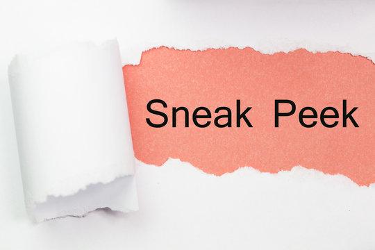 The phrase Sneak Peek appearing behind torn yellow paper.