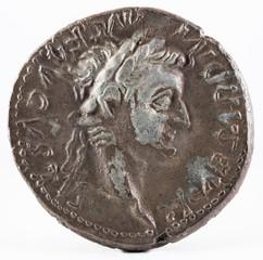 Ancient Roman silver denarius coin of Emperor Tiberius. Obverse.