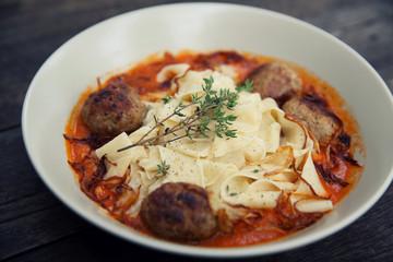 Pasta meatballs tomato sauce on wood background