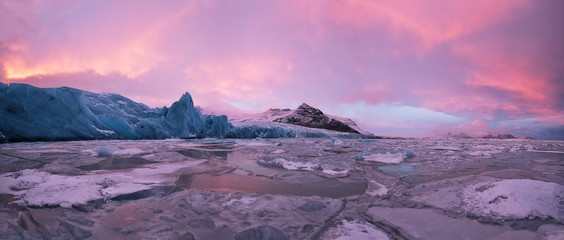 Beautiful iceberg lagoon in fjallsarlon with frozen floes, winter panoramic landscape