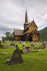 Wooden stave church with a graveyard in Lom, Norway