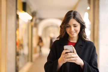 Girl sending a text message