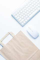 Keyboard and paper bag on white background. Online shopping or cyber Monday concept