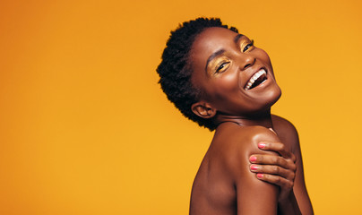 Cheerful african woman with makeup
