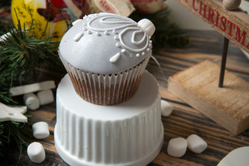 Cupcake on christmas decorated wooden table