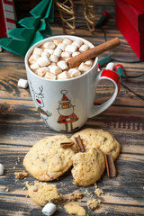 Hot chocolate with marshmallows on christmas decorated wooden table