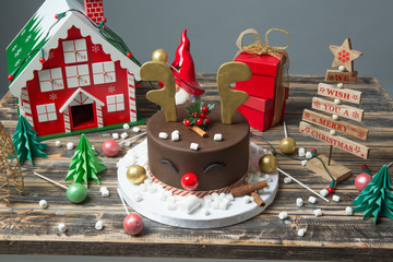 Christmas decorated chocolate cake on wooden table