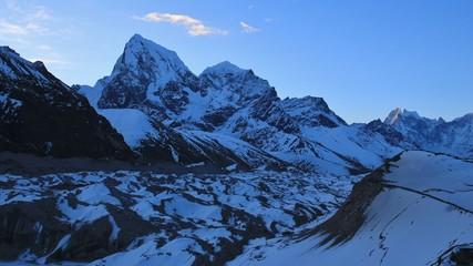 Early morning in Gokyo, Nepal. Ngozumpa glacier and mount Cholatse. Spring day.