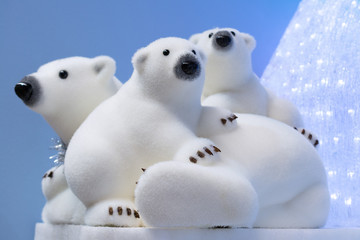 Christmas and New Year decorations: figurines of a white polar bear with cubs.