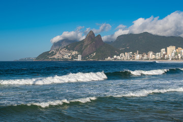 Waves in the Ocean at Ipanema Beach with Beautiful Rio de Janeiro Mountains on Horizon