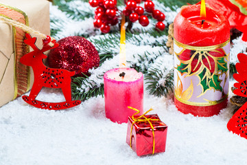 Christmas background with gift, Christmas tree branches, snow, snowflake and decorations. Free space