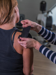 Kinesio-Taping of womans sholder