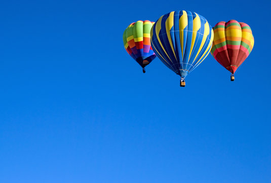 3 Colorful Balloons against a blue Utah sky.
