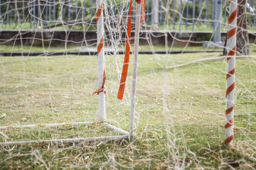 close up of mesh football goal with Artificial turf on for sport background.