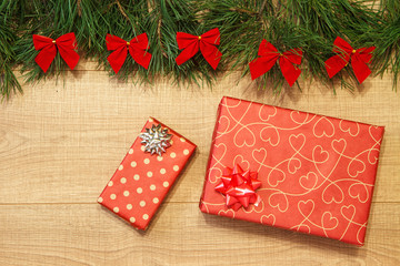 New Year / Christmas gifts in package, tree with red bows on the wooden background template