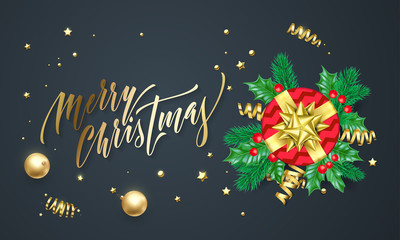 Merry Christmas golden decoration and gold font calligraphy greeting card design. Vector Christmas tree holly wreath decoration, New Year holiday red gift and confetti on black premium background