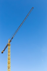 Construction crane against blue sky in morning
