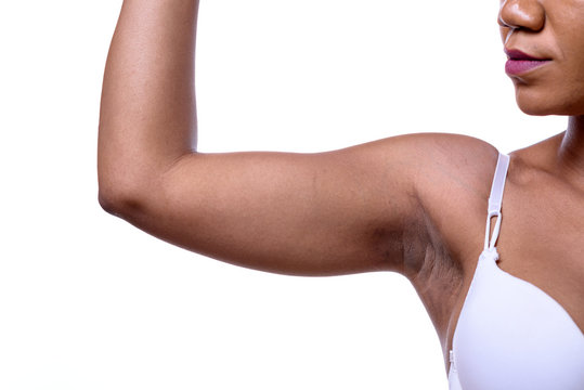 Bare shoulder and arm bent of a woman