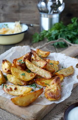 Baked potatoes with garlic, paprika and fresh parsley