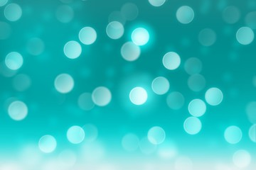 Falling snow on teal background with blurred circle bokeh, abstract background