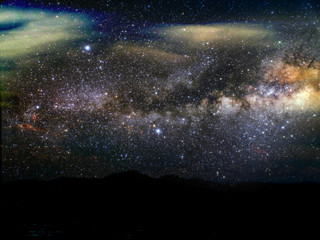 silhouette mountain and blur milky way galaxy in night