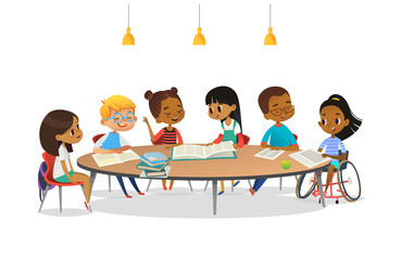 Smiling disabled girl in wheelchair and her school friends sitting around round table, reading books and talk to each other. Concept of inclusive activity. Cartoon vector illustration for banner.