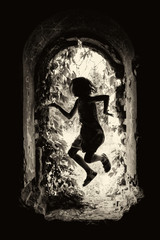 a child's silhouette in a hole